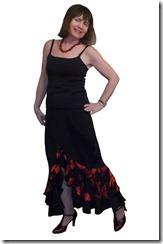 Нарядная длинная юбка с воланами и разрезом спереди