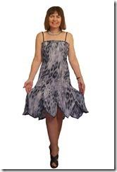 Нарядное платье на бретельках с фигурным воланом.